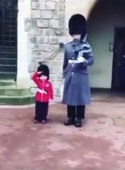 Slough boy's adorable moment with Coldstream Guards at Windsor Castle.