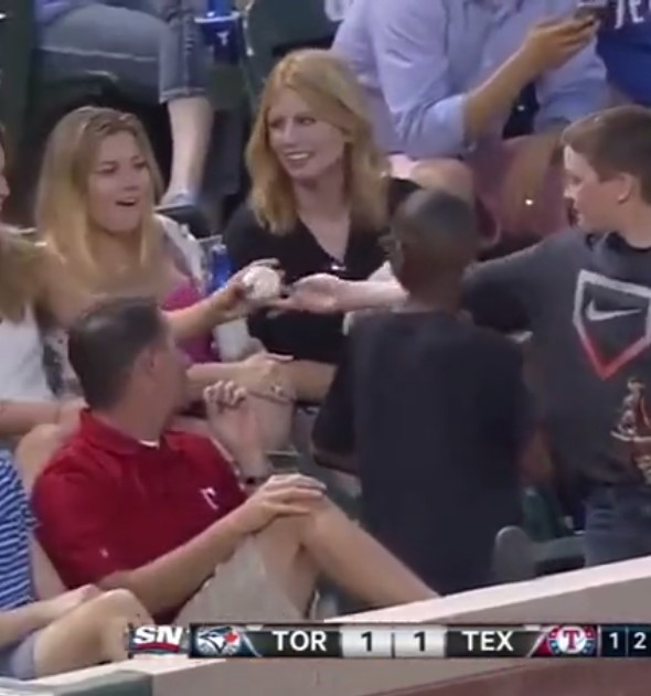 Young fan giving a girl a fake game