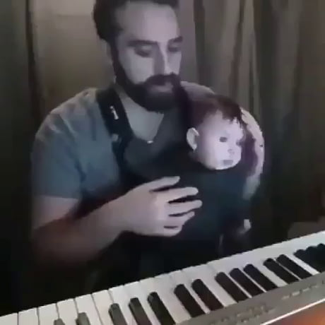 Wholesome – Dad plays music to put his infant to sleep