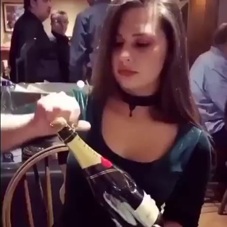 Opening a whine bottle